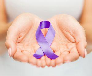 hands holding purple ribbon